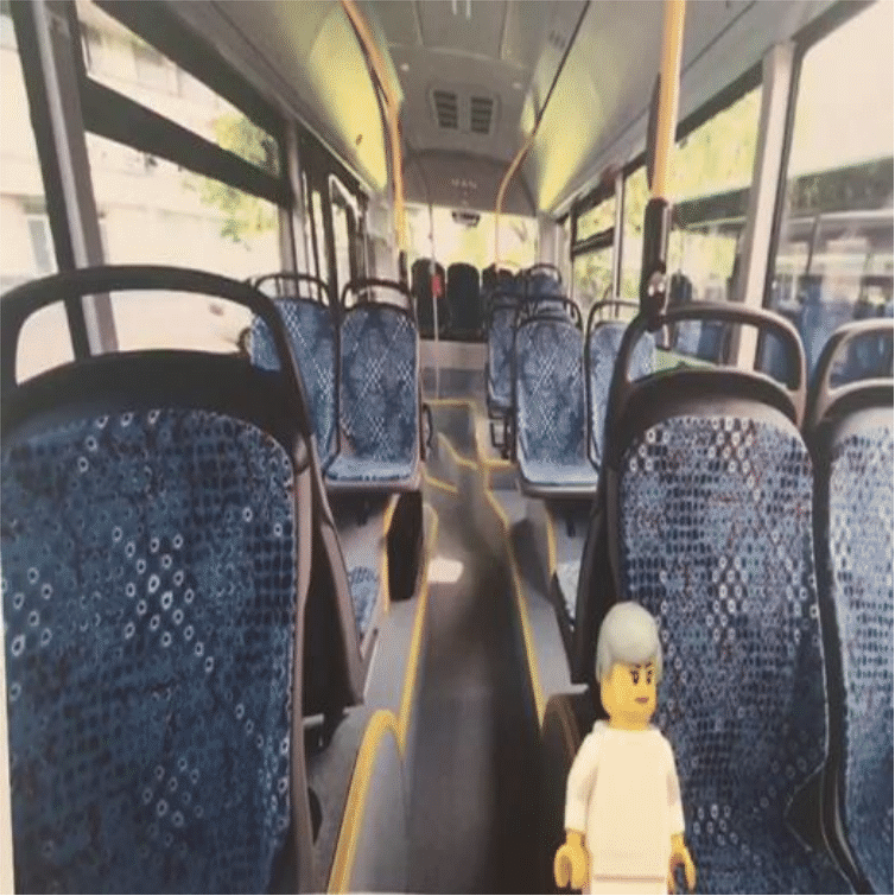 prototype of the solution BUSS. The interior of a bus and a grey-haired lego figure.