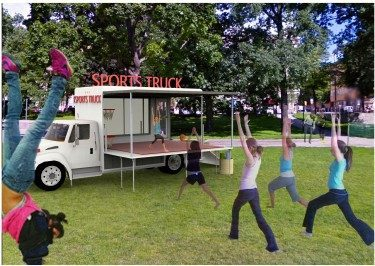 A yoga instructor teaching yoga from the Sports truck-stage.